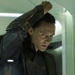 Caged Loki pounds the glass
