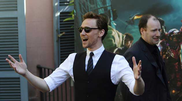 Tom Hiddleston in a Black Vest, tie, and sunglasses